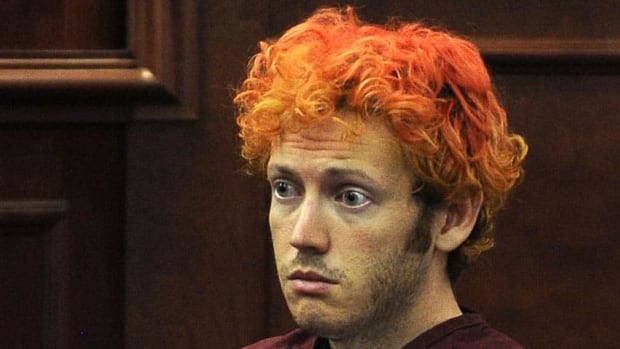 Movie-theatre shooting suspect James Eagan Holmes, at his first court appearance in Aurora, Colo., allegedly began stockpiling gear for his assault four months ago. Prosecutors are expected to file formal charges against him Monday.