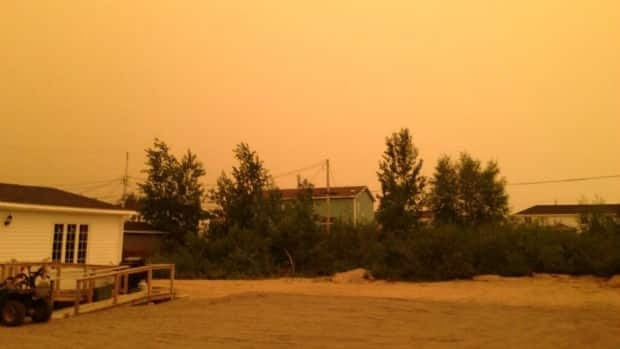 A smoky haze over Happy valley-Goose Bay left the town with an orange tint on Friday.