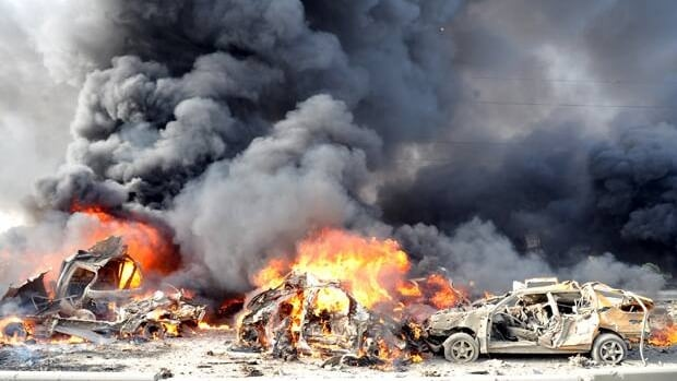 Two bombs exploded in the Qazaz neighbourhood in Damascus on Thursday, killing at least 40 and wounding 170, Syrian state-run TV says.