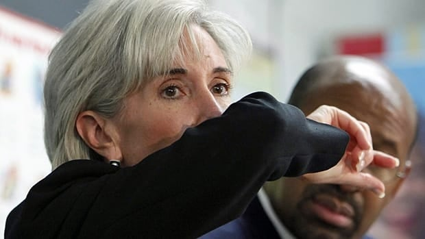 U.S. Health and Human Services Secretary Kathleen Sebelius demonstrates how to cough.  Touching the face, mouth and nose can bring viruses that are on their hands to where they can infect us.