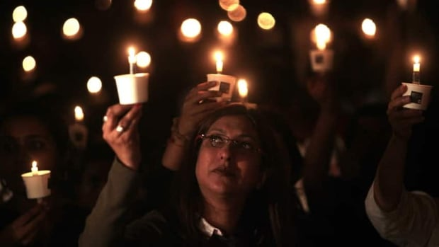 A woman holds up a candle during an Earth Hour vigil in Mumbai, India, in 2011. Earth Hour, a global call to turn off all non-essential lights for 60 minutes in a bid to highlight global climate change, takes place worldwide this year at 8.30 p.m. local time.