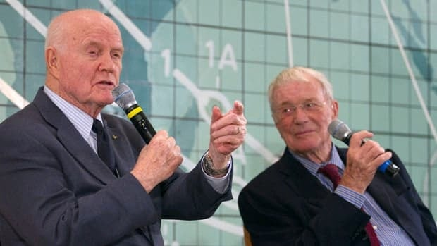 John Glenn, left, and Scott Carpenter address employees at the Kennedy Space Center on Friday in Cape Canaveral, Fla.
