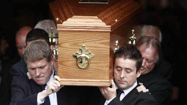 Family members carry the coffin of Irish poet Seamus Heaney from the Church of the Sacred Heart in Donnybrook, Dublin, on Monday. The Nobel Prize-winning poet's funeral drew politicians from across the political spectrum as well as poets and rock musicians.