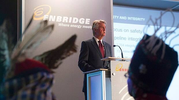 Enbridge Inc. President and CEO Patrick Daniel speaks at his company's annual general meeting in Toronto in May as John Ridsdale, Chief Namoks, of the Wet'suwet'en First Nation, right, and Chief Martin Louie of Nadleh Whut'en nation, left, listen.