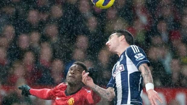 Manchester United's Danny Welbeck, top, fights for the ball against West Bromwich Albion's George Thorne during another win by the Reds on Saturday.