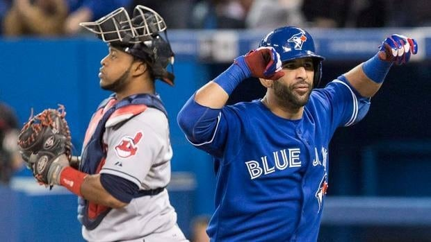 Toronto Blue Jays Jose Bautista (right) celebrates in front of Cleveland Indians catcher Carlos Santana after hitting a two run homer during the first inning on Thursday. He would injure his ankle late in the contest.