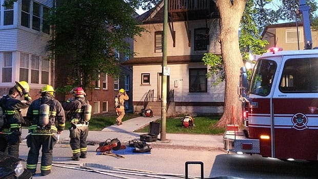 Crews clean up after a fire at a Langside Street home on Tuesday morning.