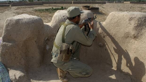 A member of the Afghan Local Police takes position at a checkpoint in Char Darah district of Kunduz province July 30, 2012.