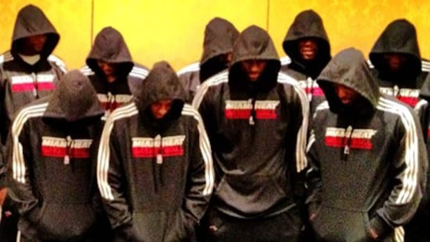 Miami Heat players pose with hoodies over their heads, in a photo posted to LeBron James's Twitter account.