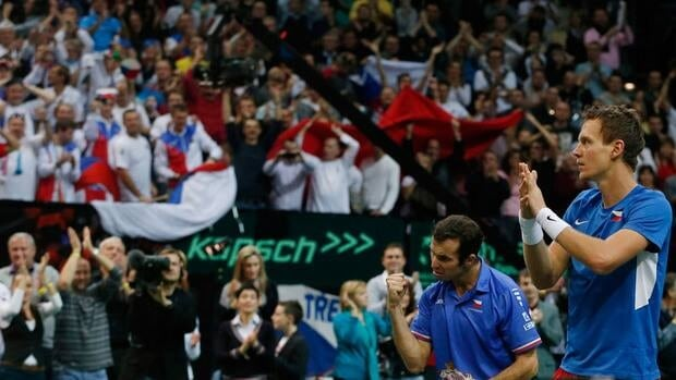 Czech Republic's Tomas Berdych, right, and teammate Radek Stepanek, left, celebrate after winning their Davis Cup finals doubles match against Spain on Saturday.