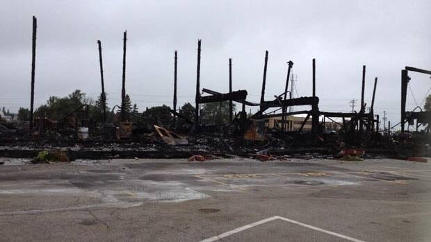 Investigators on Tuesday are combing though what is left of the fire-ravaged main building at the St. Jacobs Farmers' Market.