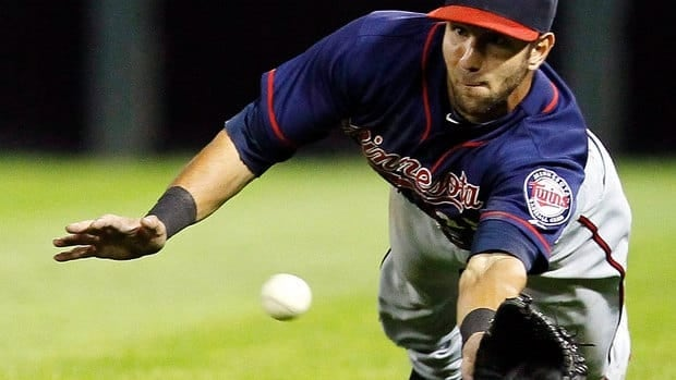 Twins outfielder Darin Mastroianni makes a play on a fly ball in a July game against the Chicago White Sox that was first called a trap, then over turned by a conference of umpires to a catch.