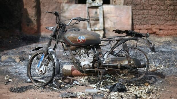 In the town of Konna a motorcycle stands charred where the al-Qaeda linked group are searching for a way out of the extremist movement in the wake of French air strikes.