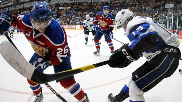 Edmonton Oil Kings' Kristians Pelss, left, is seen battling for the puck in a round-robin Memorial Cup game in Shawinigan, Que., in 2012.