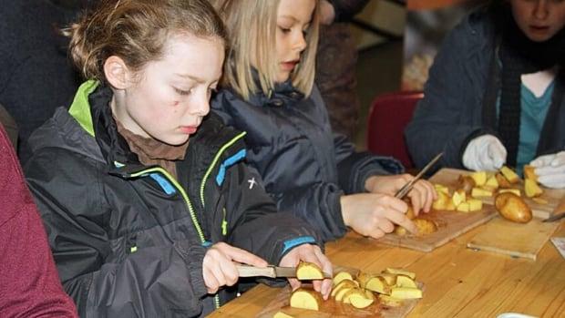 Children chop vegetables at a Schnippeldisko in Berlin on Friday.