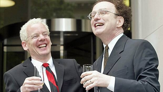 Michael Stark, left, and Michael Leshner celebrate with champagne after their marriage in Superior Court in Toronto on June 10, 2003. The couple had been together for 22 years and were finally allowed to marry following a court ruling.