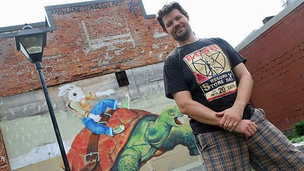 Supercrawl organizer Tim Potocic says he's trying to get more people from out of town to make the trek to downtown Hamilton for Supercrawl. Here, he's pictured in the lot by the Tivoli Theatre, where the first Supercrawl stage was set up in 2009.