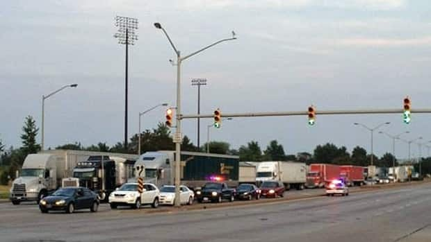 Trucks began lining up at 8 p.m. Monday, minutes after a bomb threat at the Ambassador Bridge.