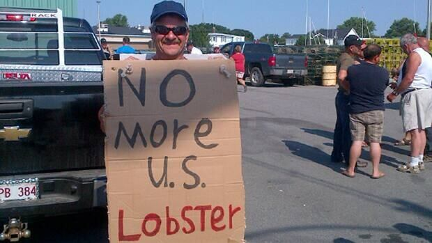 Fishermen met to discuss their options about their upcoming season while cheap American lobster are being processed in N.B.