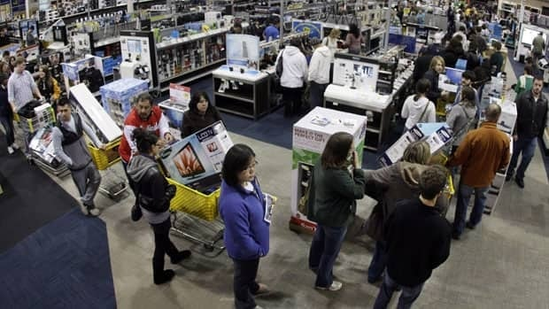 A checkout line winds through a Best Buy store as shoppers take advantage of a midnight Black Friday sale last year in Tennesse. While Canada may not see the same level of crowds, Black Friday has become a big shopping event here.