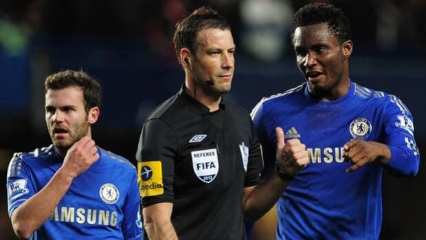 Chelsea midfielder John Obi Mikel, right, protests to referee Mark Clattenburg on Oct. 28.