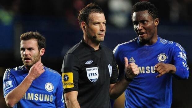 Chelsea midfielder John Obi Mikel, right, protests to referee Mark Clattenburg on Oct. 28.