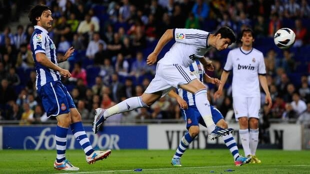 Real Madrid's Alvaro Morata heads the ball towards goal against Espanyol.