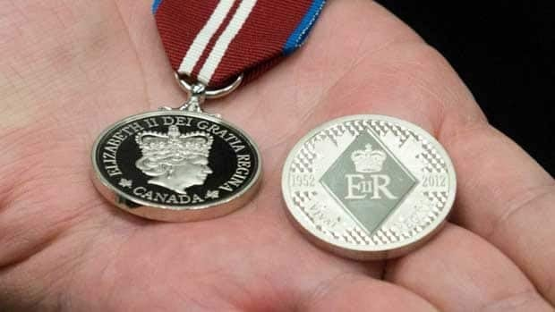 Federal Heritage Minister James Moore displays the medals that have been handed out to commemorate the Queen's Diamond Jubilee in the past year.
