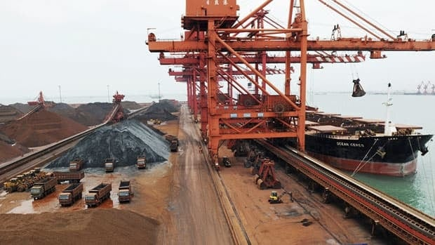 The value of the two-way merchandise trade between China and Australia, such as the export of iron ore to this port in China's Shandong province, has surged almost 700-fold in the 36 years to 2009.