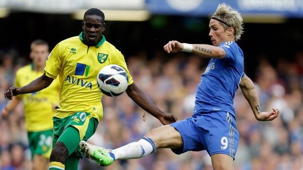 Chelsea's Fernando Torres, right, controls the ball against Norwich's Leon Barnett during their match on Saturday.