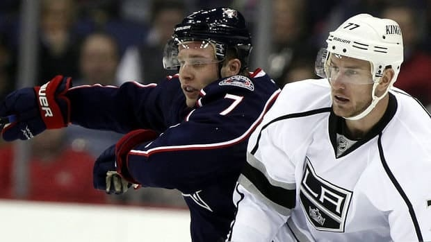 Blue Jackets defenceman Jack Johnson, left, is seen with the man he was traded for last February, Jeff Carter of the Kings. Johnson loves the opportunity he's been given in Columbus, even if it meant missing out on Stanley Cup title with Los Angeles last June.