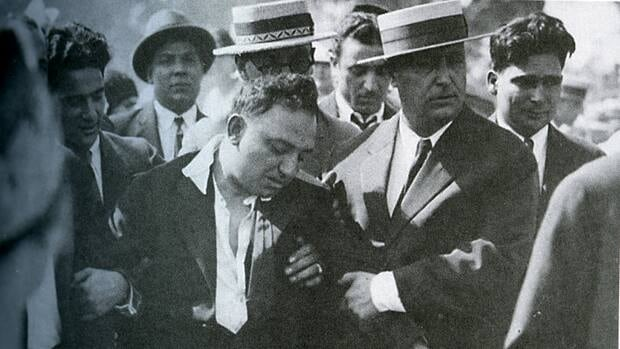 Rocco Perri, centre, was a broken man at the 1930 funeral of his murdered lover Bessie Starkman. A couple of weeks later he signed a will. Now a lawyer who represents his family wants to take a good look at that will.