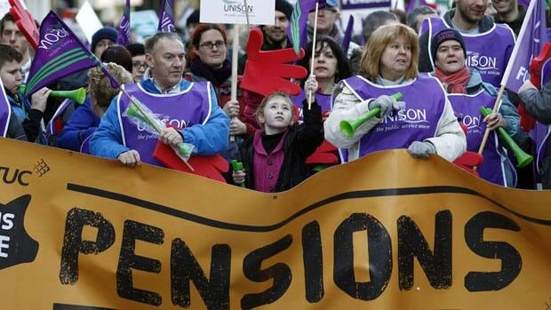 Marchers gather in Manchester, England, as part of a one-day public sector strike on Nov. 30, 2011. The strike was called to protest the British government's plan to make public sector pensions less generous in the years ahead.