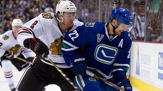 Blackhawks defenceman Duncan Keith, left, is taking heat for a comment he made to a Vancouver reporter who questioned his two-handed stick swipe to the back of Canucks forward Daniel Sedin, right, on Monday night.
