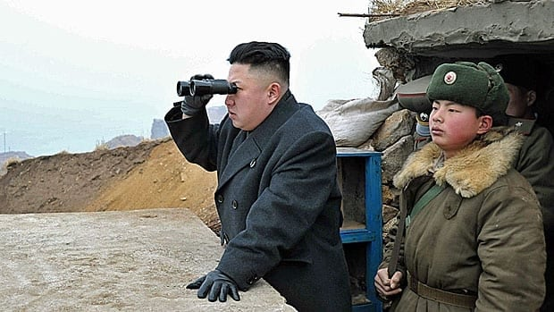 North Korean leader Kim Jong-un looks south during his visit to the Jangjae Islet Defence Detachment and Mu Islet Hero Defence Detachment near the border with South Korea, on March 7,2013. He says he is ready for war.