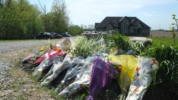 Dozens of flowers from friends and strangers line the driveway to the Bosma's home.