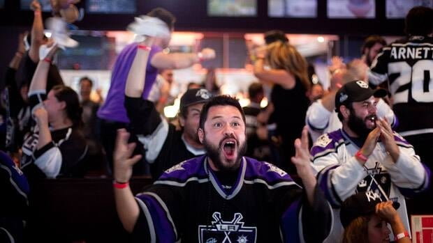 Fans celebrate a goal scored by the Los Angeles Kings during Game 6 in Los Angeles, California.