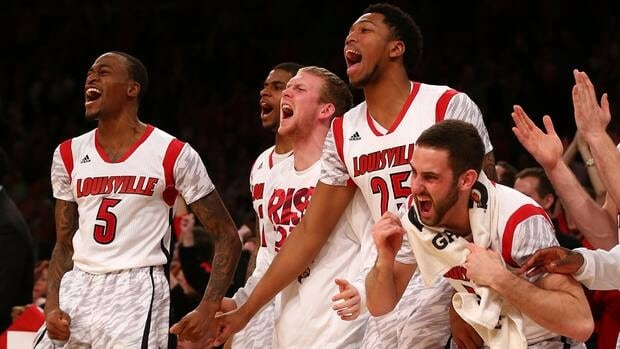 The Louisville Cardinals earned the top seed in the NCAA tournament after pulling off a stunning comeback to beat Syracuse in the Big East tournament final Saturday.
