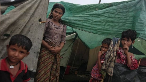 A family from Pauktaw township is shown at a Rohingya internally displaced persons camp outside of Sittwe, Burma. Authorities have struggled to evacuate tens of thousands of people, most of them Rohingya Muslims, before Cyclone Mahasen arrives.