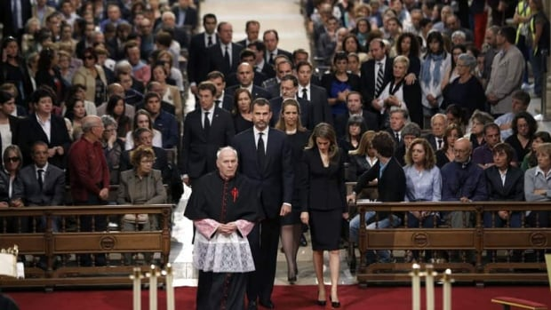 Prince Felipe, centre, and Princess Letizia, front, arrived with members of the Spanish government in Santiago de Compostela's cathedral Monday evening to mourn the 79 people killed in last week's train crash.