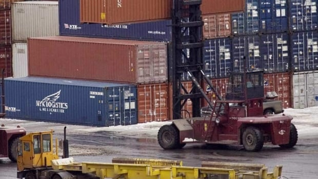 Stevedores move shipping containers at the Halifax port. Ottawa had set a loose deadline of the end of the year to iron out a free trade deal with the European Union.