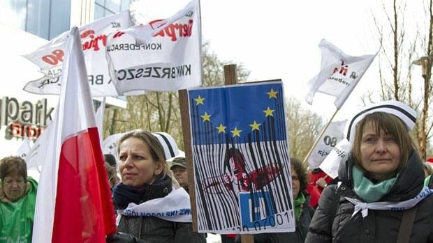 Polish nurses protest against austerity cuts outside an EU summit in Brussels Thursday.