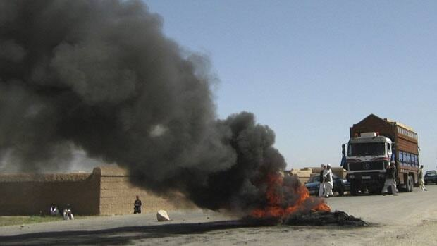 Burning tires block a highway in Wardak province, Afghanistan, where an ailing, pregnant Caitlan Coleman and husband Josh were last seen.