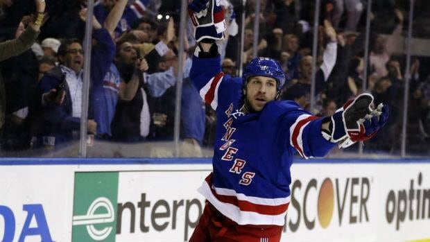 Ryane Clowe celebrates a goal in May when he was playing for the New York Rangers.