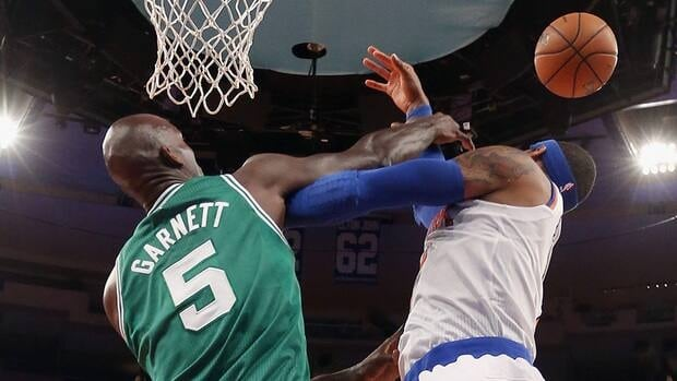Kevin Garnett of the Boston Celtics is seen here battling with Carmelo Anthony of the New York Knicks at Madison Square Garden on Monday in New York City.