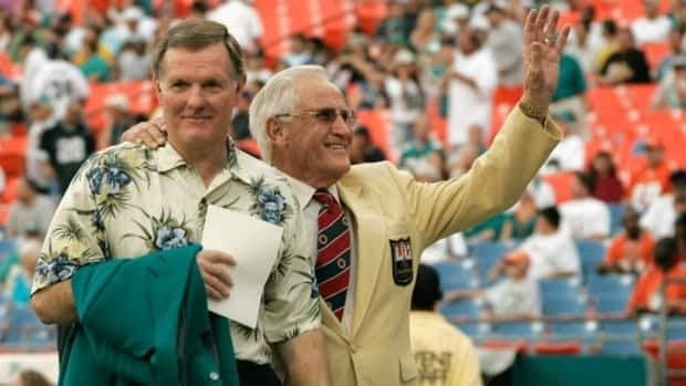 Former Miami Dolphins quarterback Bob Griese, left, and coach Don Shula, right, wave to the crowd in this Dec. 16, 2007 file photo, in Miami, as the two celebrated the 35th anniversary of the 1972 undefeated football team.