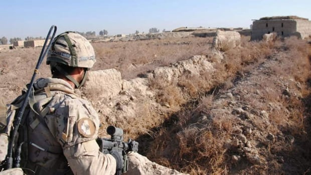A Canadian soldier eyes a compound of interest during an operation in the village of Khenjakak, Afghanistan. Canadian troops quietly stopped handing captured Taliban fighters over to Afghan authorities in mid-2011.