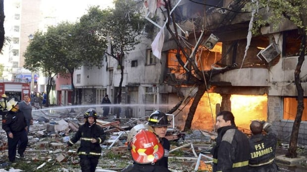 Flames are seen after a fire erupted following an explosion caused by a gas leak in an apartment building in Rosario city, in the province of Santa Fe.