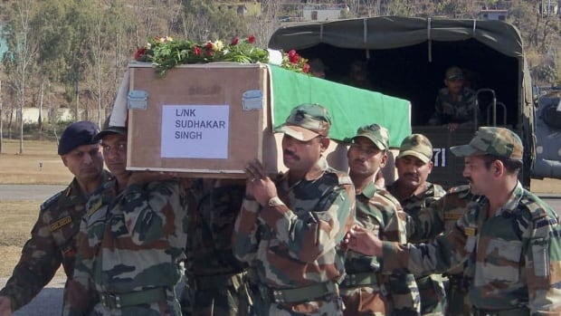 Indian Army soldiers carry a coffin containing the body of a colleague, who was allegedly killed by Pakistani soldiers, at Rajouri, India, on Wednesday. India summoned Pakistan's top diplomat in New Delhi to formally complain about an attack on an Indian army patrol in the disputed Himalayan region of Kashmir that killed two soldiers.