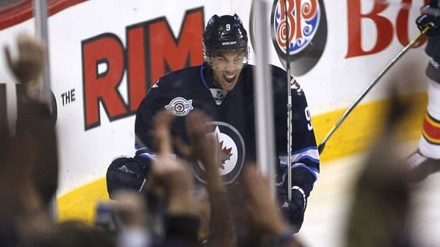 The Winnipeg Jets' Evander Kane celebrates after scoring on Florida Panthers goalie Jose Theodore during the first period in Winnipeg on Thursday.